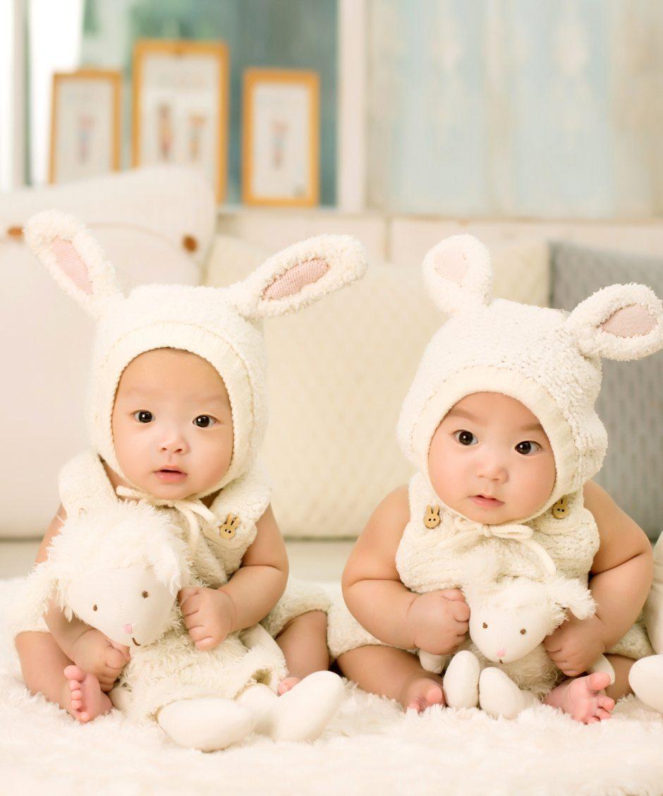 2-babies-wearing-white-headdress-white-holding-white-plush-36039